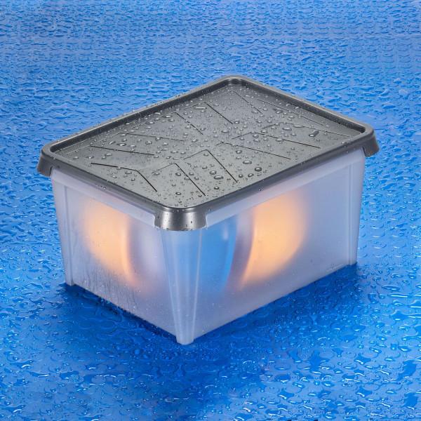 Wasserdichte Kunststoffbox mit Regentropfen und bunter Füllung